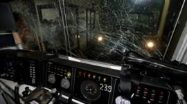 A smashed window from the control cabin of a subway train