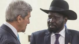 South Sudan's President Salva Kiir, right, listens to U.S. Secretary of State John Kerry