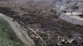 Afghan villagers gather at the site of a landslide at the Argo district in Badakhshan province, May 2, 2014