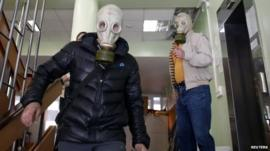 Pro-Russia rebels wearing gas masks