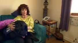 Tricia O'Brien with care dog Barclay