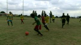 South African teenagers playing football