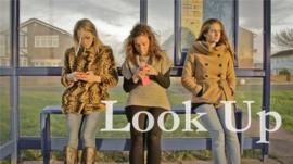 Three women at bus stop