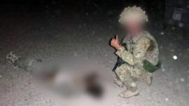 Photo purportedly showing RAF serviceman with dead insurgent