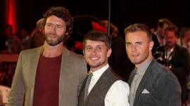 Take That members (L-R) Howard Donald, Mark Owen and Gary Barlow