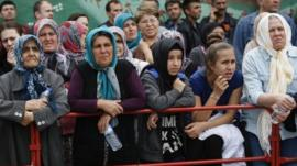 Relatives of miners wait in front of an hospital in Soma