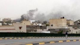 Smoke rises over Libya's parliament buildings in Tripoli