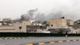 Smoke rises over Libya's parliament buildings in Tripoli