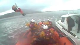 Paramedic winched aboard lifeboat