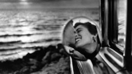A couple kiss, California, 1955
