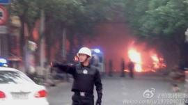 Police near presumed scene of attack in Urumqi (22 May)