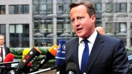 David Cameron talks to reporters