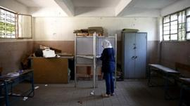 An Egyptian voter selects a candidate at a polling station in the Cairo