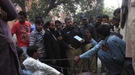 Police collect evidence near body of Farzana Iqbal