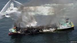 Smoke raises from the fuel tanker Shoko Maru after it exploded off the coast of Himeji, western Japan