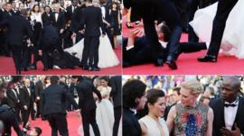 Vitalii Sediuk blocked by minders as he tries to get under US actress America Ferrera's dress as she arrives for the screening of the animated film How to train your Dragon 2 at the 67th edition of the Cannes Film Festival in Cannes, southern France, on May 16 2014