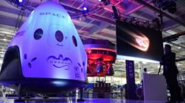 SpaceX CEO Elon Musk unveils Spaces new seven-seat Dragon V2 spacecraft, at a press conference in Hawthorne, California