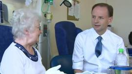 NHS chief executive Simon Stevens with a patient