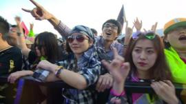 Chinese young people enjoy a rock concert