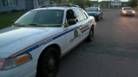 Police car wrapped in scene of crime tape in Moncton, New Brunswick