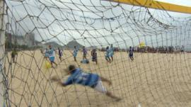 Brazilian's playing football on the beach ahead of the World Cup