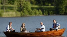 David Cameron, Angela Merkel, Fredrik Reinfeldt and Mark Rutte talk in a boat near the summer residence of the Swedish Prime Minister
