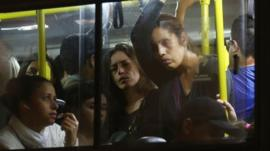Commuters stand on a crowded bus during a tangled evening commute on June 9