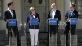 Dutch Prime Minister Mark Rutte, German Chancellor Angela Merkel, Swedish Prime Minister Fredrik Reinfeldt and British Prime Minister David Cameron