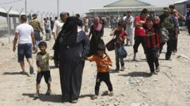 Families fleeing the violence in the Iraqi city of Mosul