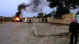 Security vehicle burns in Mosul, 10 June