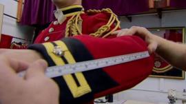 Someone measuring uniform