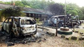 Charred vehicles sit outside a police station in Mpeketoni, in Lamu county along the Kenyan coast, after some 50 heavily-armed gunmen attacked the town near the coastal island and popular tourist resort of lamu the night before