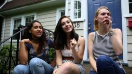 Girls sitting on a stoop