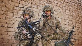 Royal Marines testing communications equipment before going out on patrol in Afghanistan