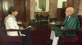 Lyse Douset speaking to Hamid Karzai