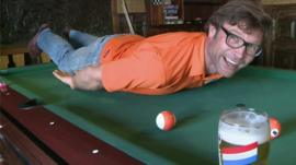 A fan 'Persieing' on a pool table
