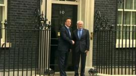 David Cameron and Herman Van Rompuy shake hands on the doorstep of Number 10.