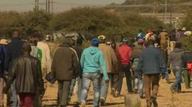 Miners returning to work in South Africa