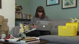 Woman working with laptop on sofa
