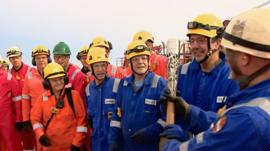 Queen's baton on an oil platform