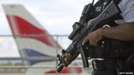 Armed police officers patrol at Heathrow Airport terminal