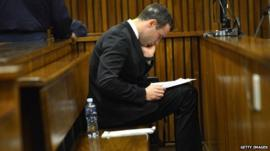 Oscar Pistorius sits in the dock at the Pretoria High Court on July 7, 2014