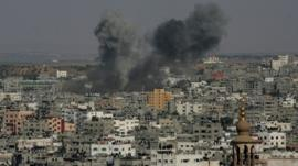 Smoke billows from buildings following an Israeli air strike on Gaza City