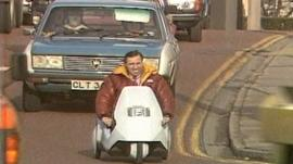 BBC Wales reporter Elfyn Thomas drives a Sinclair C5 in Cardiff city centre in 1985