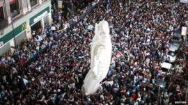 Aerial view of packed streets and inflatable Christ the Redeemer statue