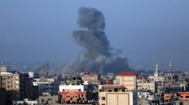 Smoke rises after a strike in Gaza City on Thursday, July 10, 2014