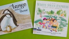 Pictures of And Tango Makes Three and The White Swan Express, two books banned by the Singapore National Library Board in July 2014.