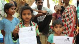Children holding certificates
