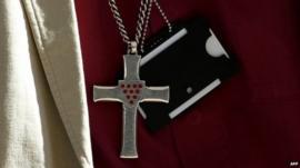 General Synod member wearing cross