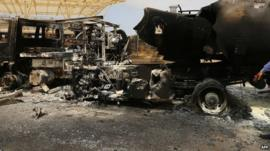The wreckage of a truck and an airplane at Tripoli international airport